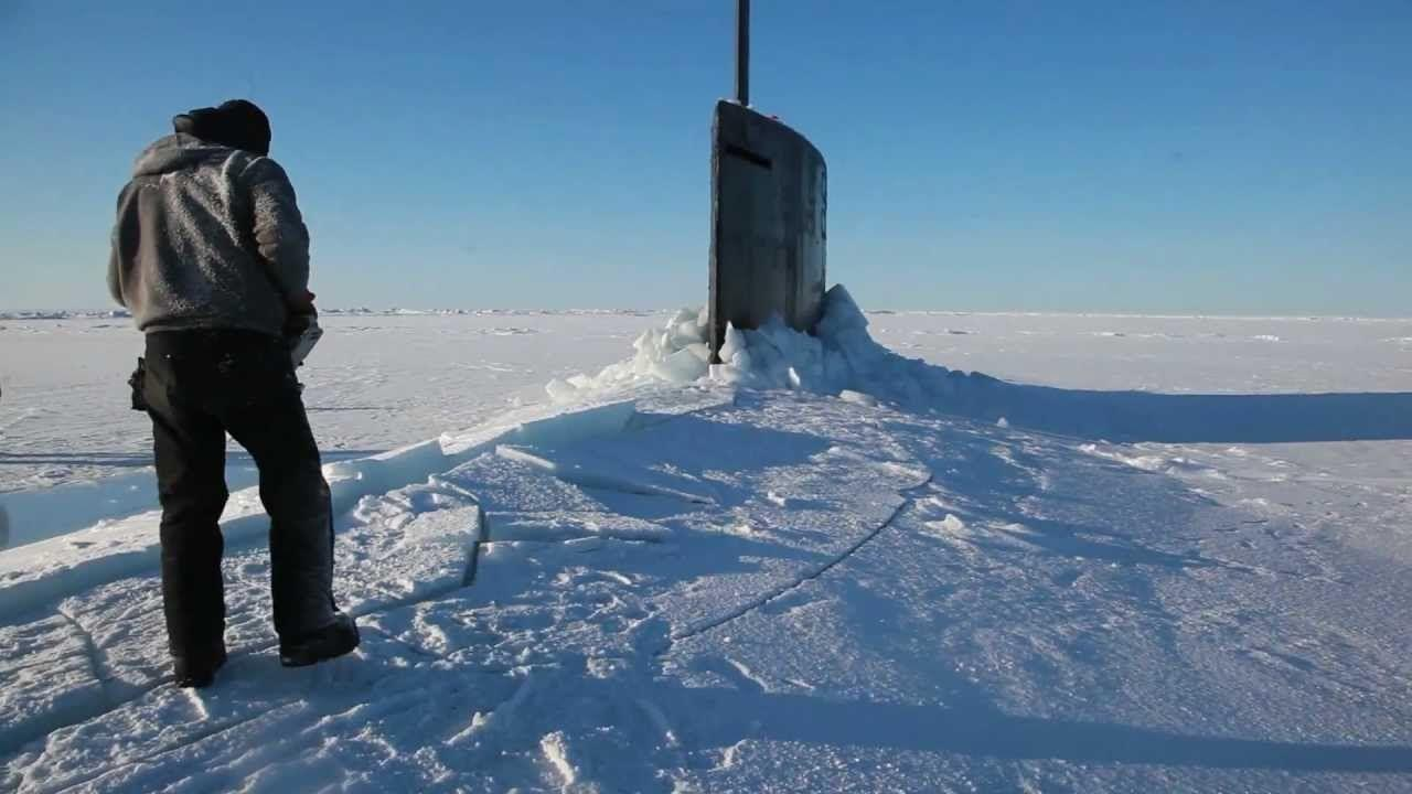 Nuclear submarine surfaces in frozen ice. http://www.howitworksdaily.com/how-long-can-modern-submarines-remain-underw...